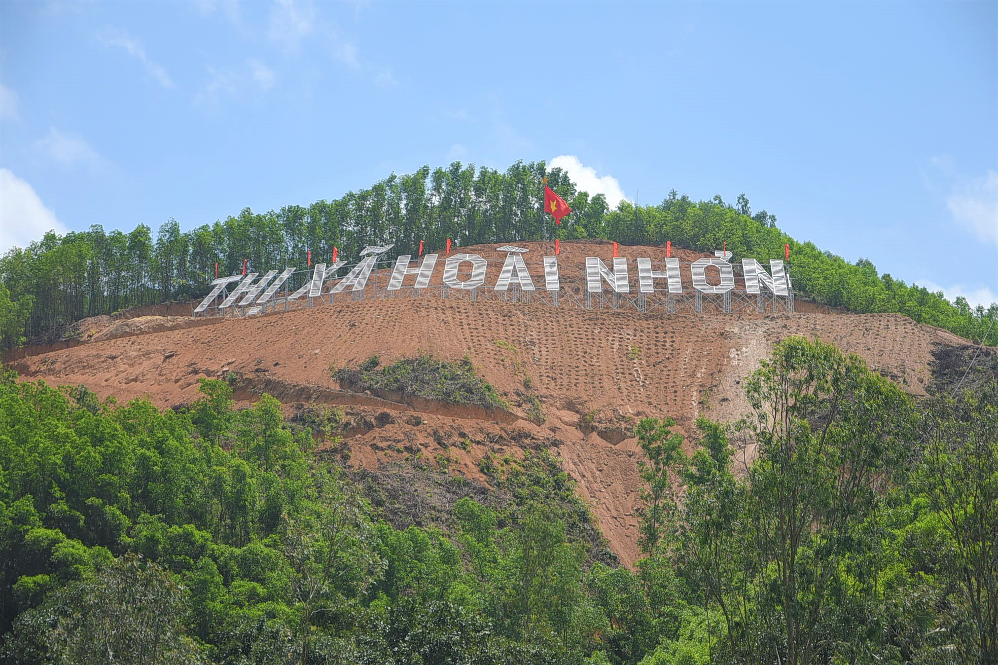 South-central Vietnamese town says to afforest after deforestation for landmark sign
