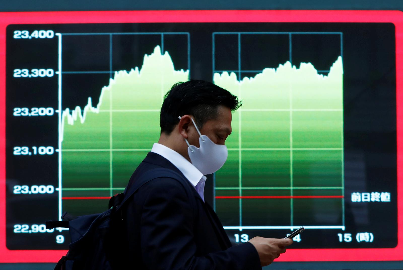 World stocks inch up on increasing bets on faster economic recovery