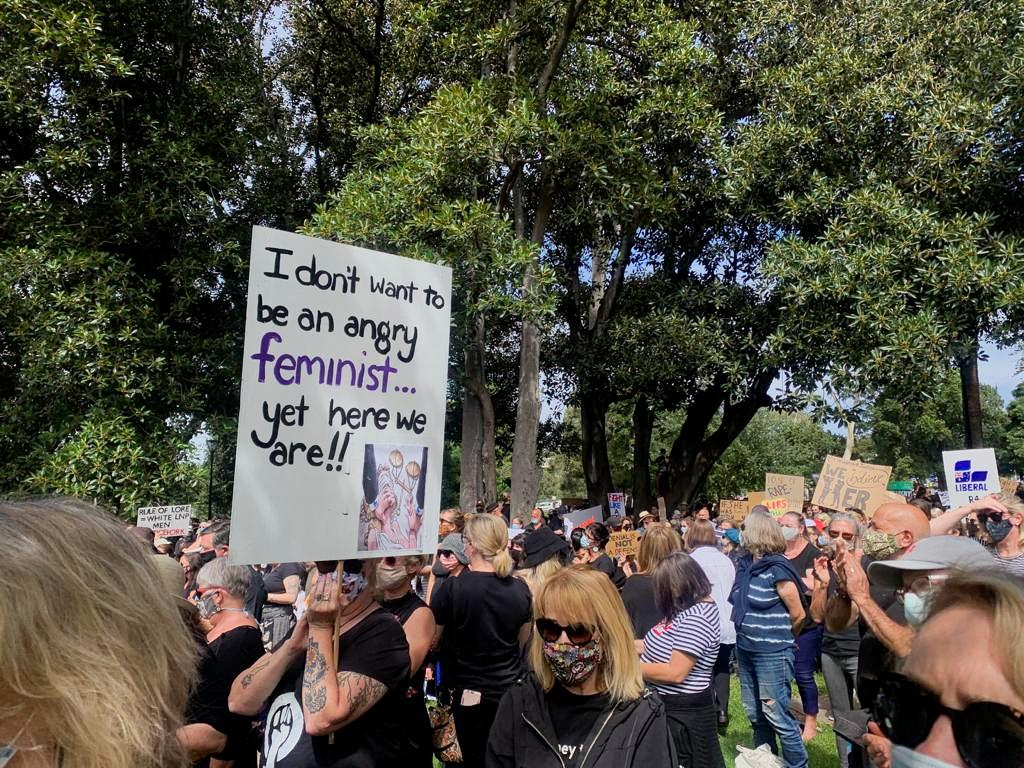 Black-clad women rally in Australia to demand gender violence justice
