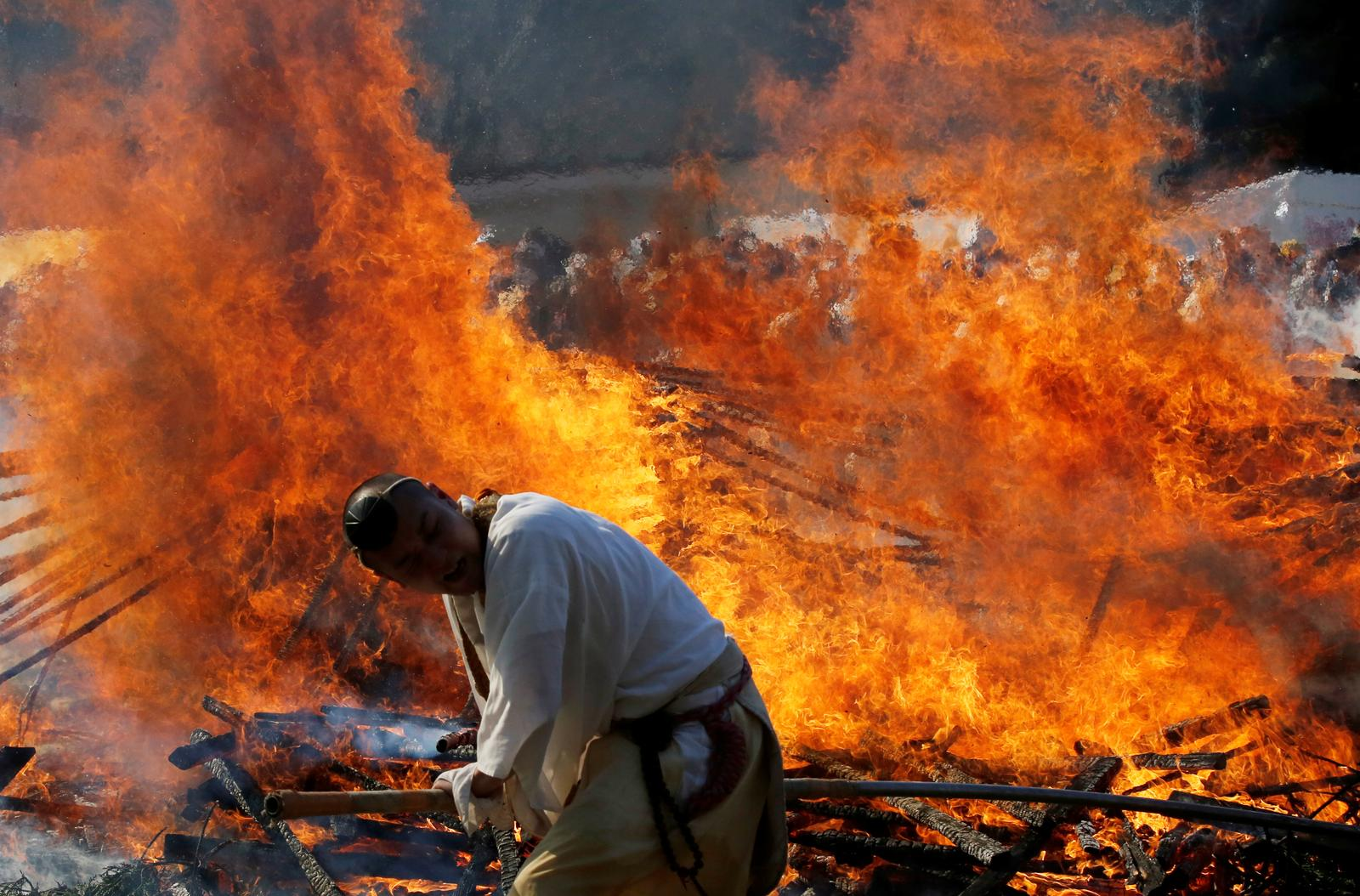 Japan worshippers brave smouldering coals to pray for safety