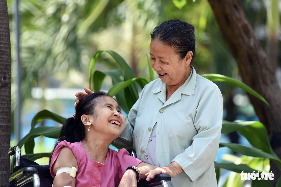 Elderly Vietnamese woman's constant fight to keep terminally ill daughter alive