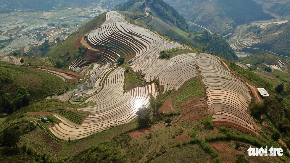 A bird's eye view of the terraced paddy fields in Cu Vai Village in the northern province of Yen Bai during flooding season. Photo: Ngoc Quang / Tuoi Tre
