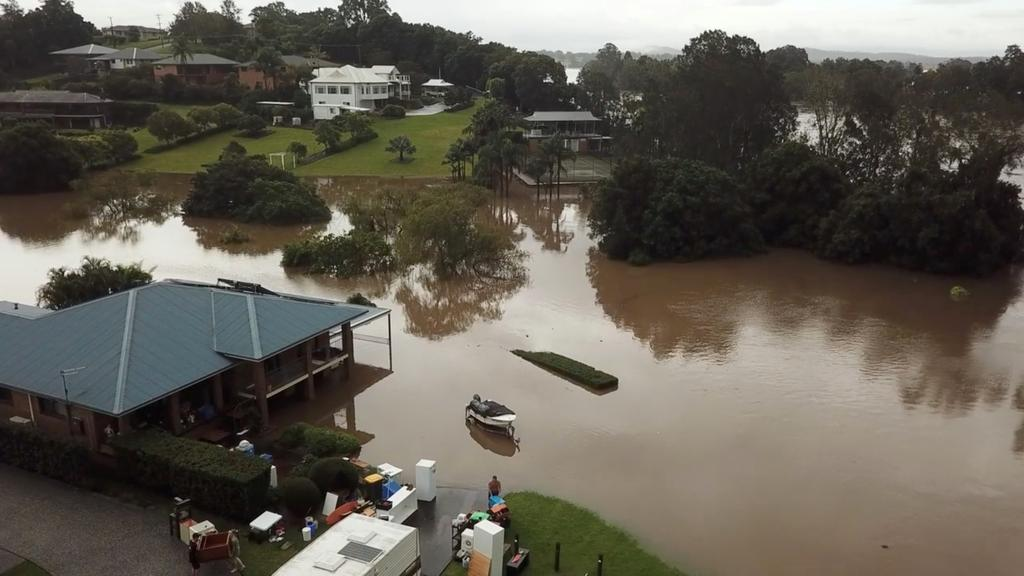 People move their belongings during floods after heavy rainfall in Tinonee, New South Wales, Australia March 20, 2021, in this still image taken from drone video obtained from social media. Photo: Mandatory credit SIMMI VALGEIRSSON/ via Reuters