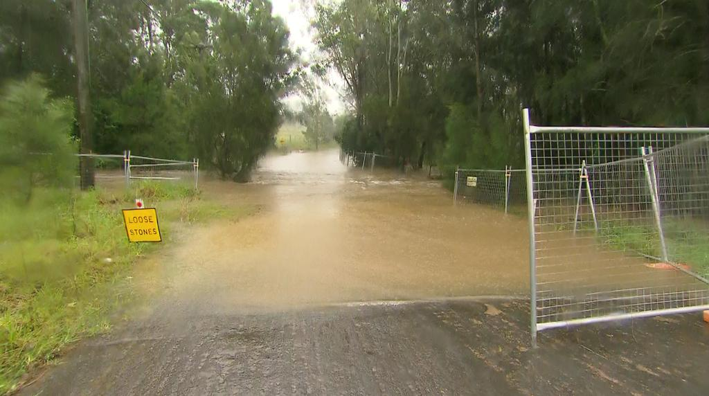 A still image taken from video shows a flooded area following heavy rains in Edmondson Park, Sydney, New South Wales, Australia March 20, 2021. Photo: NSW State Emergency Service/via Reuters