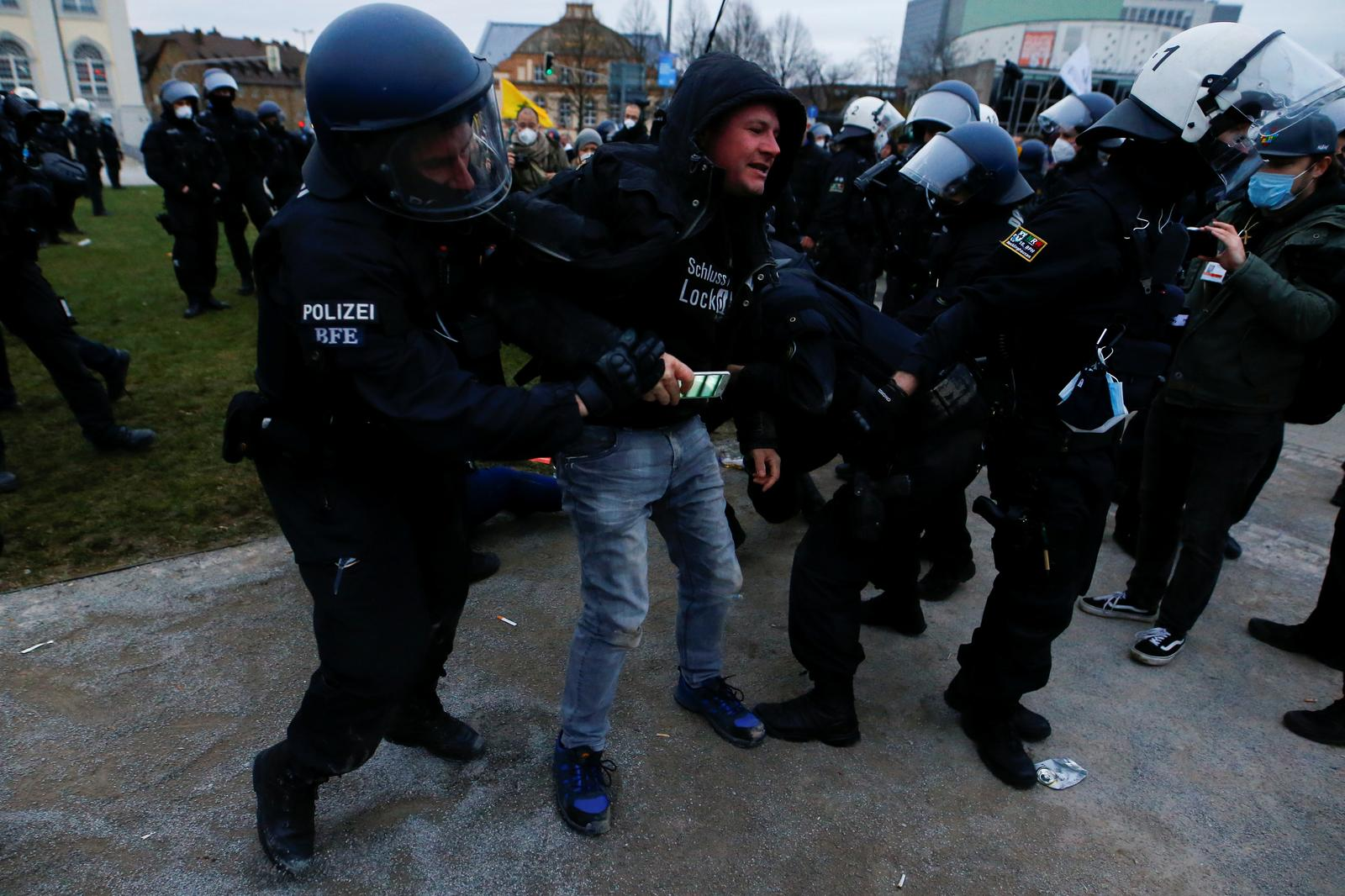 Police use water cannon as German lockdown protest turns violent