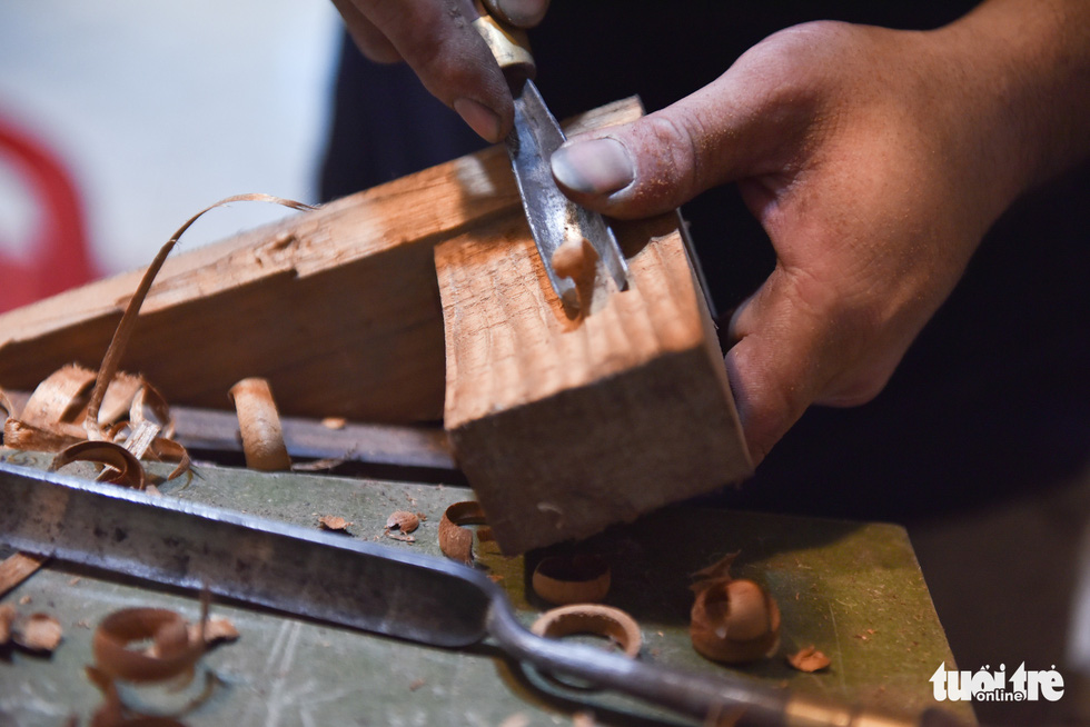 A piece of a guitar is carefully carved by hand. Photo: Ngoc Phuong/Tuoi Tre