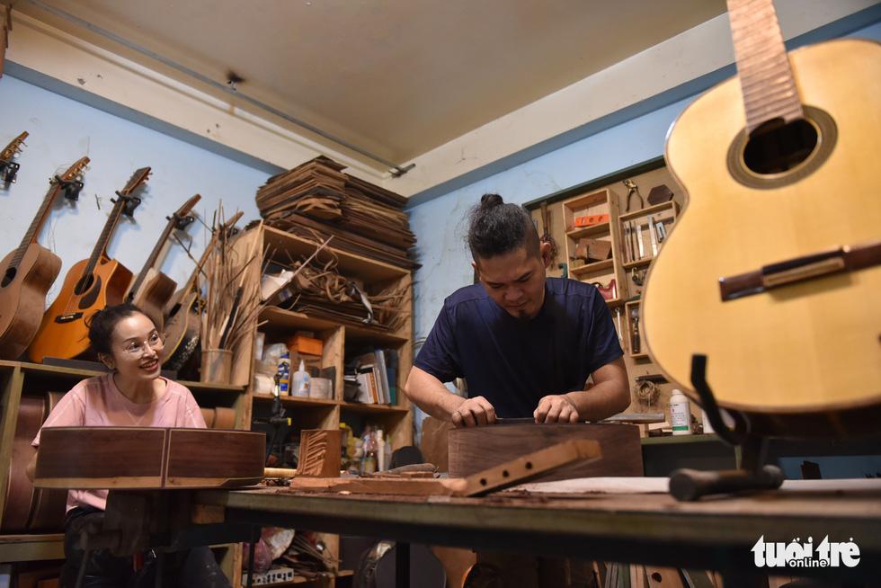 A couple's custom guitar workshop outside of Ho Chi Minh City