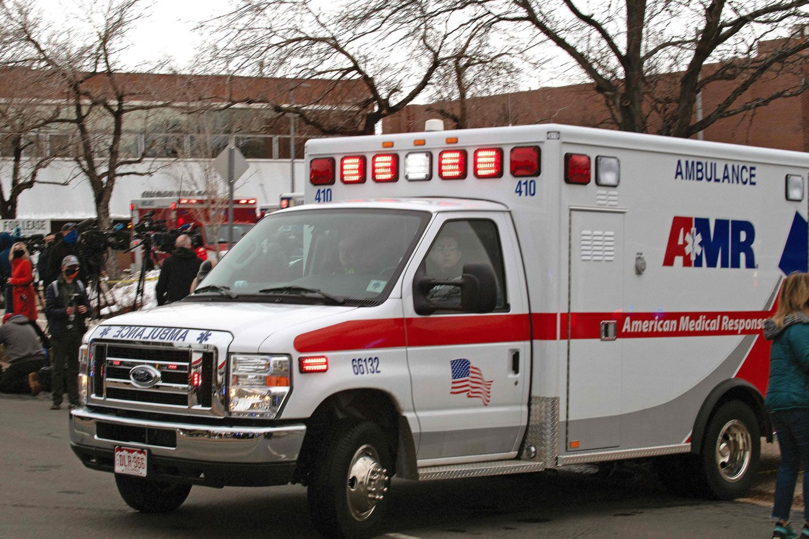 An ambulance leaves the parking lot of the King Soopers grocery store in Boulder, Colorado. Photo: AFP