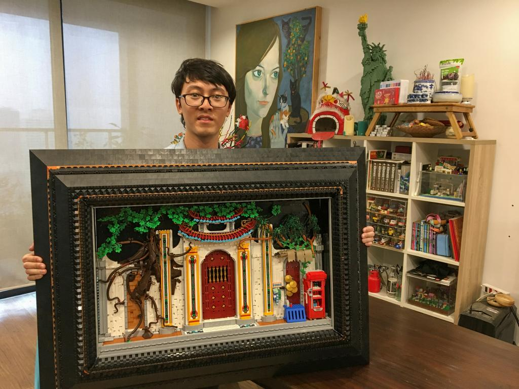 Hoang Dang, an industrial designer who loves Lego since he was a child poses in front of his pieces at his home in Hanoi, Vietnam March 13, 2021. Photo: Reuters