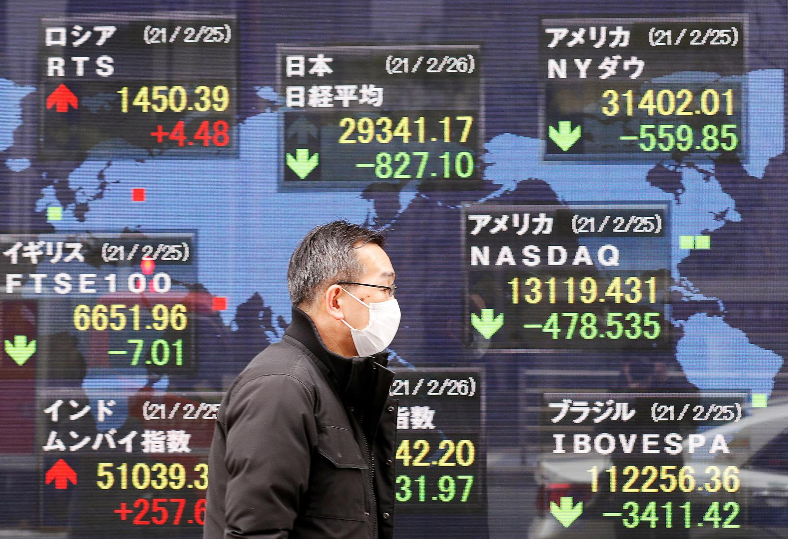 Asian shares slip, dollar rises on flight to safety