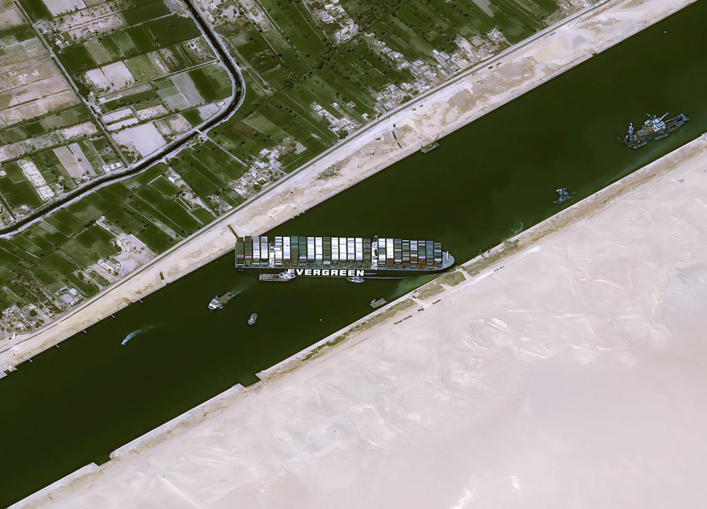 Suez Canal Authority restarts tugging attempts to free stranded ship