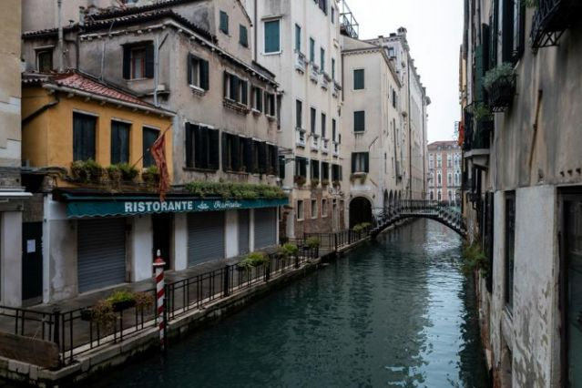 A closed restaurant in Venice. Nearly 100,000 companies in Italy's tourism sector are at risk of bankruptcy, according to the research institute Demoskopika, with a potential loss of 440,000 jobs. Photo: AFP