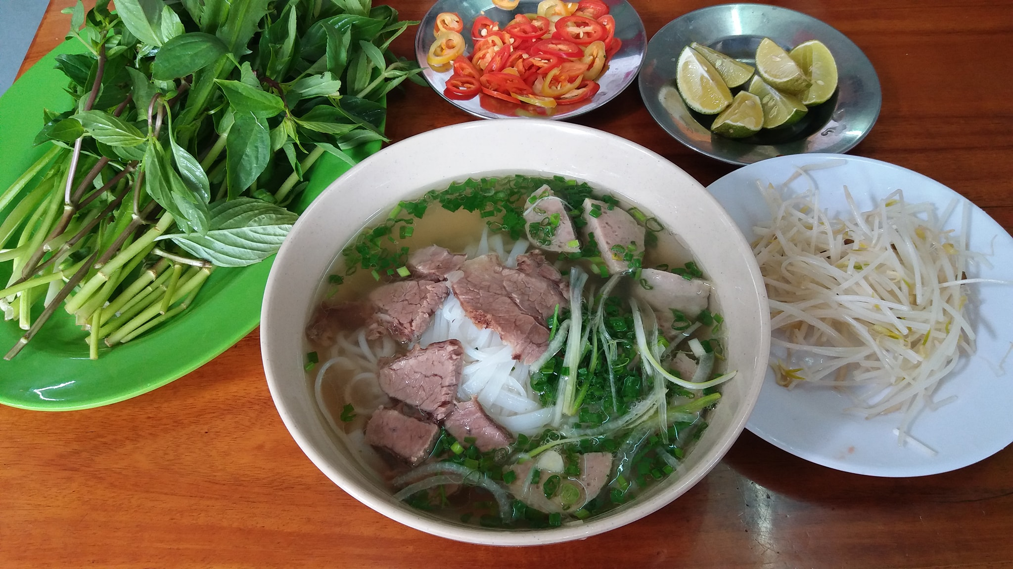 Southern-styled pho topped with flank steak and beef meatballs, served with mung bean sprouts and herbs at a longstanding pho restaurant in the Mekong Delta of Dong Thap's Cao Lanh City. Photo: Viet Toan / Tuoi Tre News