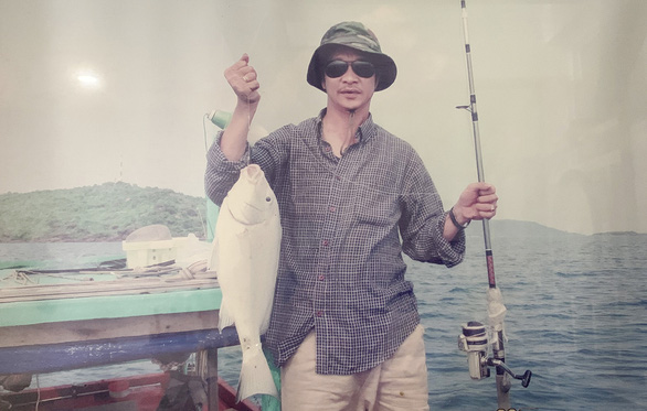 Thuc poses with a fish he caught on a trip in this supplied photo.