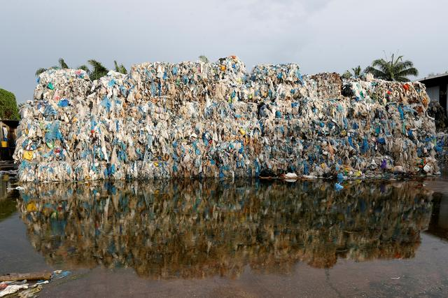 Plastic waste piled outside an illegal recycling factory in Jenjarom, Kuala Langat, Malaysia October 14, 2018. Photo: Reuters