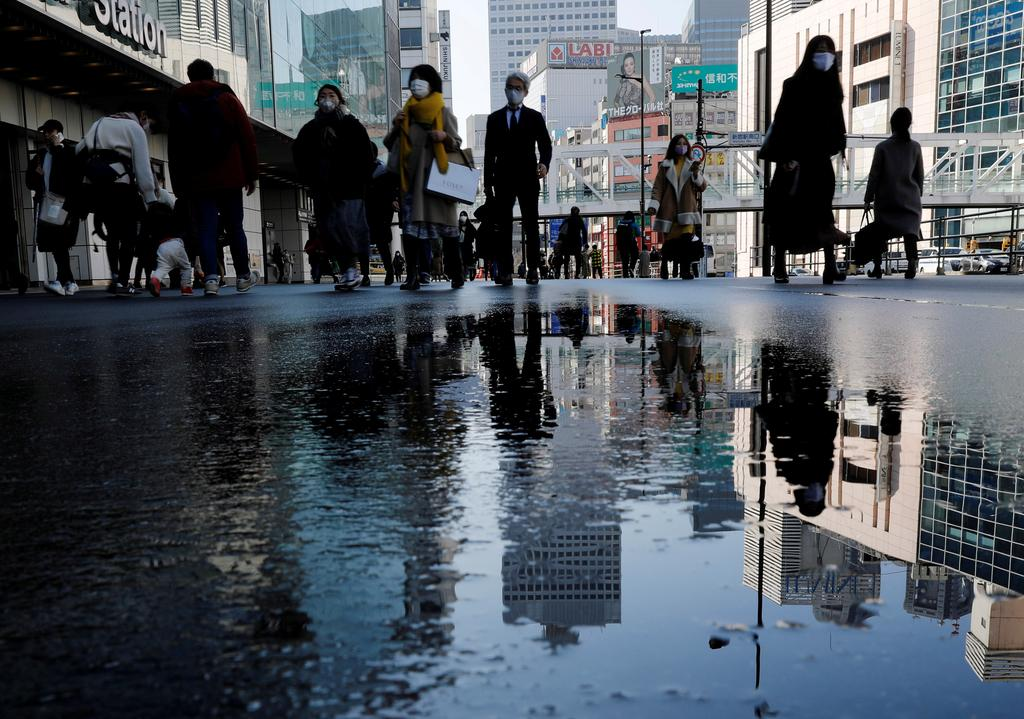 Japan business mood improves to pre-pandemic levels on global recovery hopes