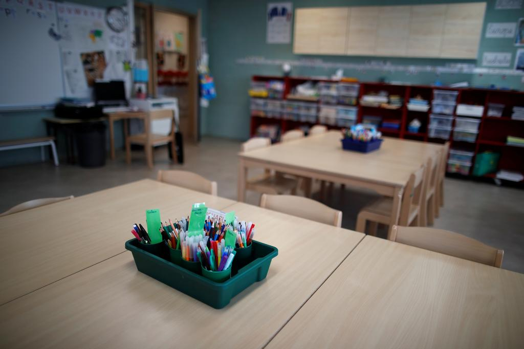 Tables and chairs are seen in a closed classroom at the private primary school Jeanne D'Arc in Saint-Maur-des-Fosses, near Paris, amid the coronavirus disease (COVID-19) outbreak in France, March 30, 2021. Photo: Reuters