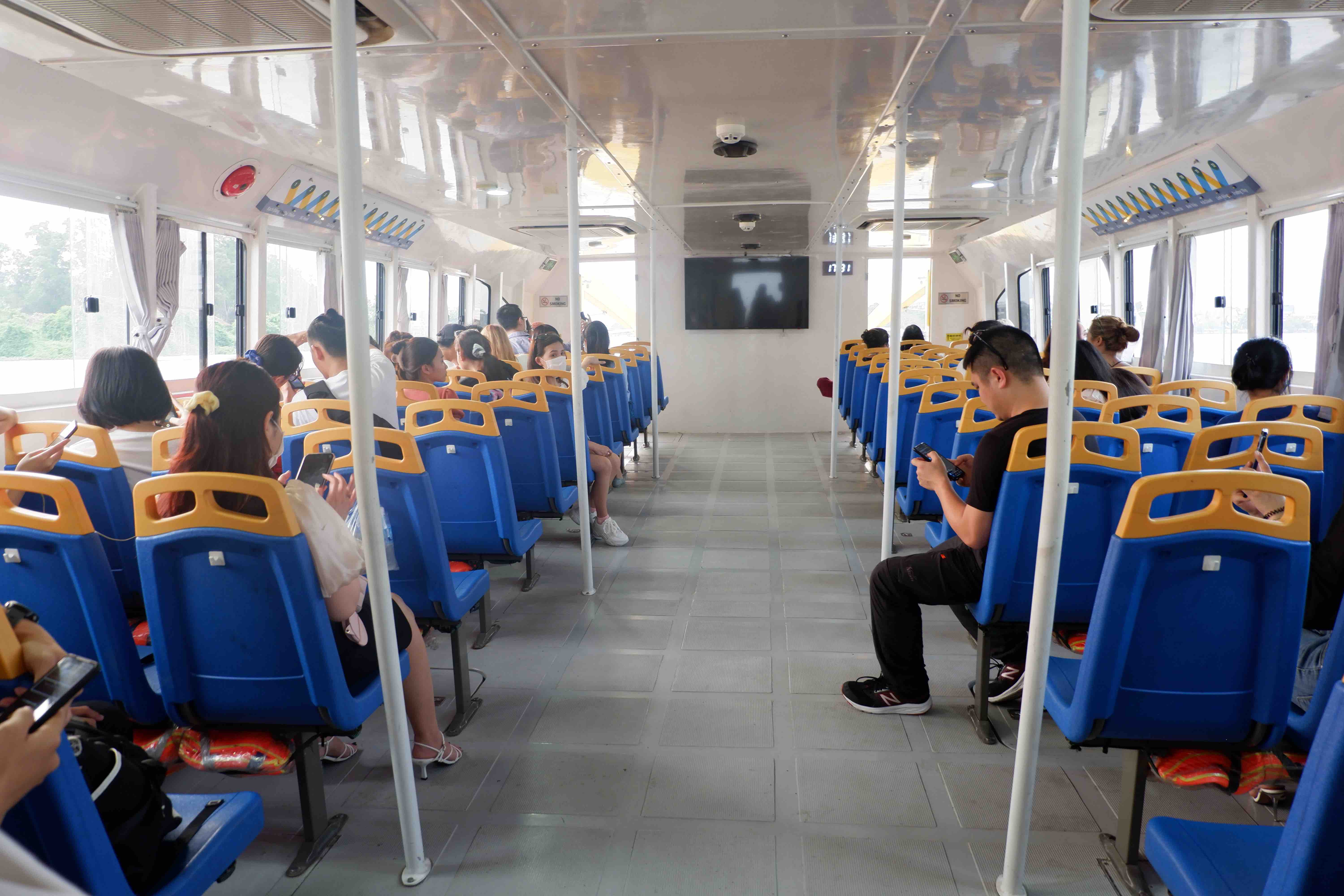 Travelers sit in the cabin of the Saigon Waterbus on March 31, 2021. Photo: Linh To / Tuoi Tre