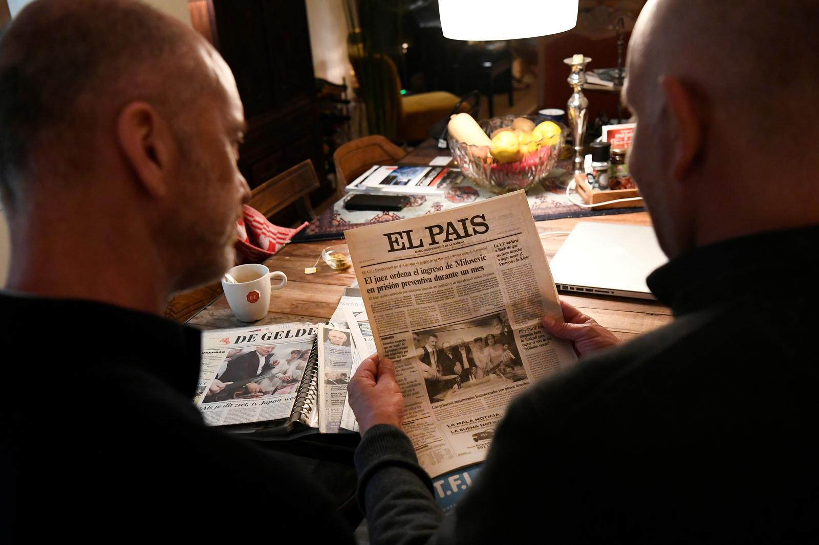 Dutch couple Gert Kasteel and Dolf Pasker look at newspaper articles that featured them on their wedding 20 years ago in the world's first legally-recognised same-sex wedding and on the state of LGBT rights two decades on, in Weesp, Netherlands March 31, 2021. Picture taken March 31, 2021. Photo: Reuters