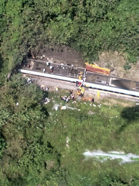 Rescue workers are seen by a train which derailed in a tunnel north of Hualien, Taiwan April 2, 2021, in this handout image provided by Taiwan's National Fire Agency. Photo: Taiwan's National Fire Agency/Handout via Reuters