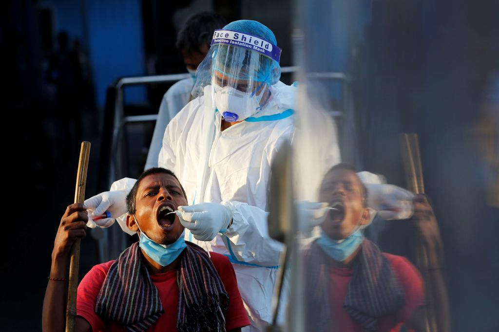 India braces for COVID-19 curbs as infections hit 6-month high