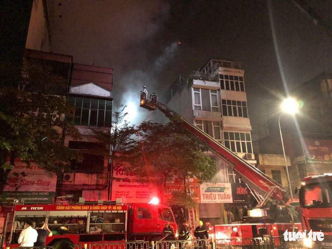 Four family members killed as fire engulfs baby store in Hanoi