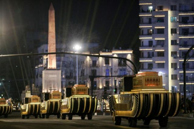 The carriages carrying 22 ancient Egyptian royal mummies advance past the Obelisk of Ramses II along Tahrir Square as they depart from the Egyptian Museum to their new home. Photo: AFP