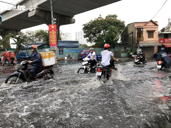 Ho Chi Minh City's inundation flashpoint deep in floodwater after brief rain