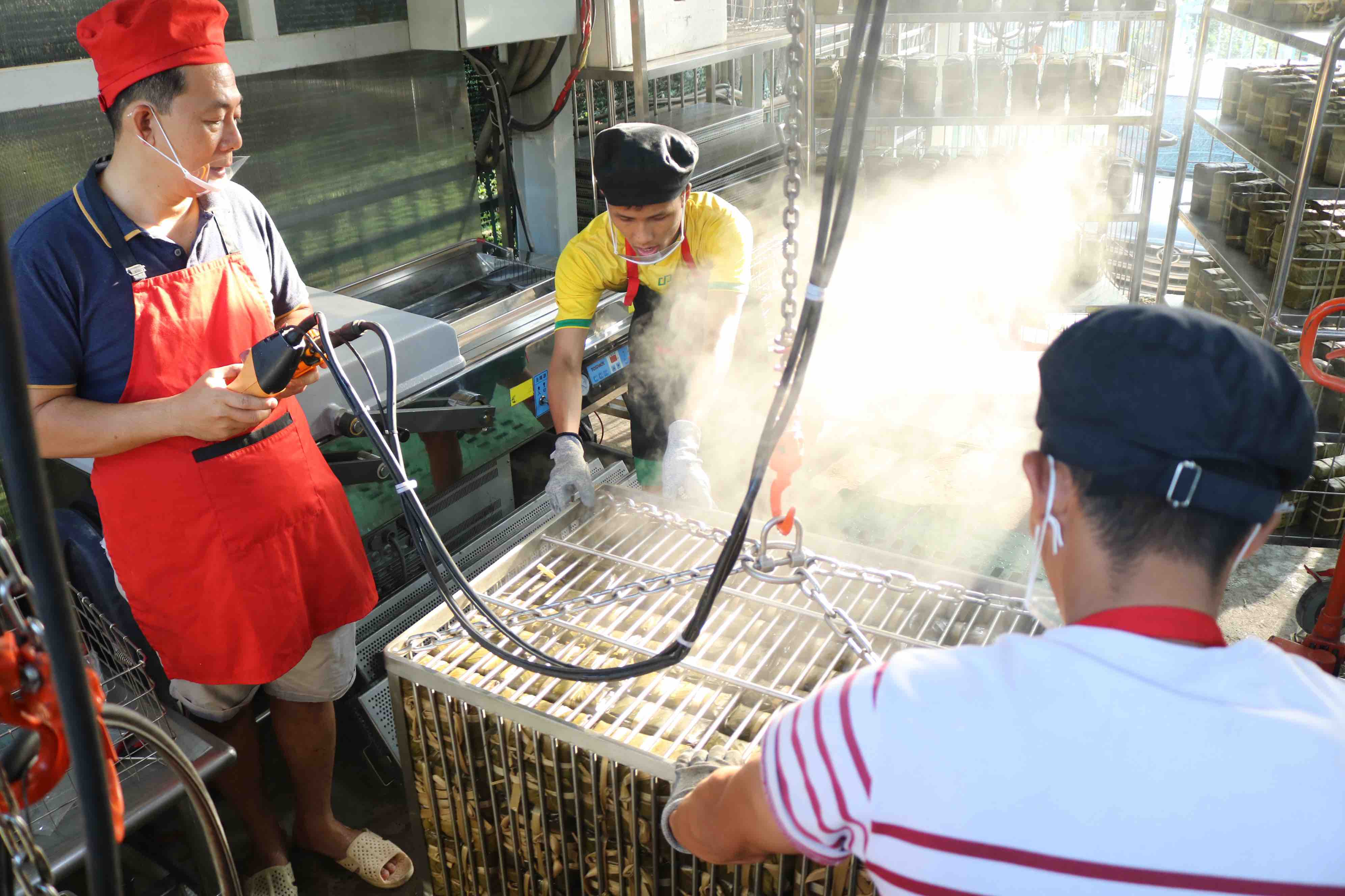 Pham Khac Tuong waters the new batch to reduce the temperature at his facility in Thu Duc City. Photo: Hoang An / Tuoi Tre