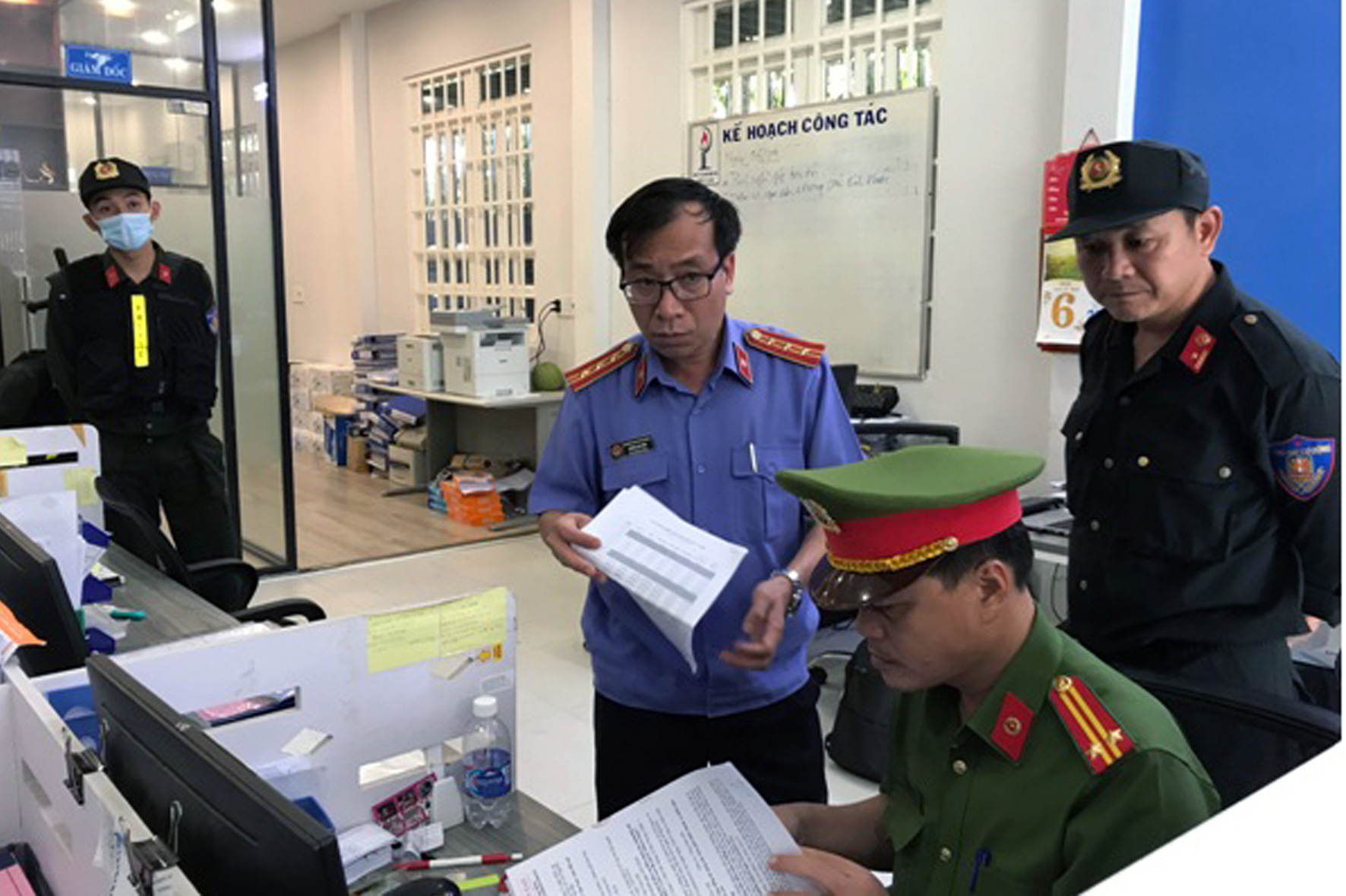 Police inspect the headquarters of Phuc Lam Petro JSC in Ho Chi Minh City, April 7, 2021 in this supplied photo