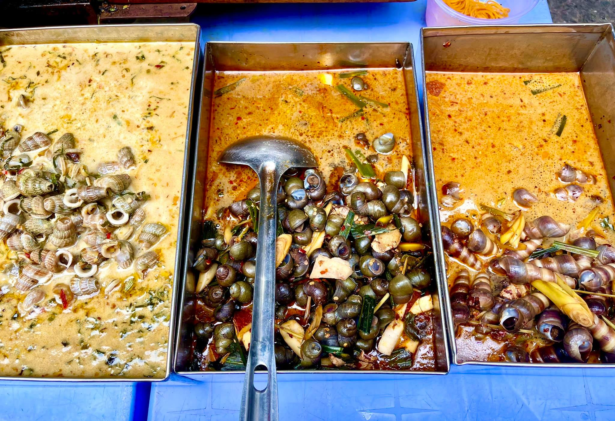 A photo provided by Jordy Trachtenberg shows snail dishes sold at a stall at Ba Hoa Market in Ho Chi Minh City's Tan Binh District.