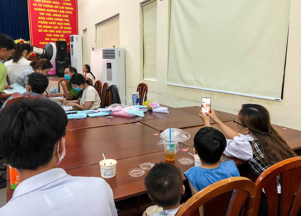 A household is waiting for their turns at a registration booth for chip-based ID card in Ward 9, Go Vap District, Ho Chi Minh City, April 6, 2021. Photo: Minh Hoa / Tuoi Tre
