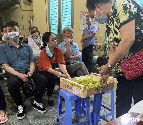 Vietnamese police offer food, entertainment as queue for ID registration lasts till midnight