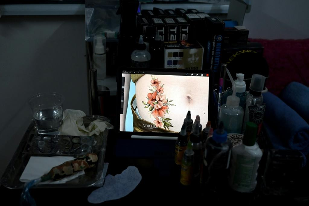 Ngoc has decided to focus her tattooing work on women with scars, both physical and mental. Photo: AFP