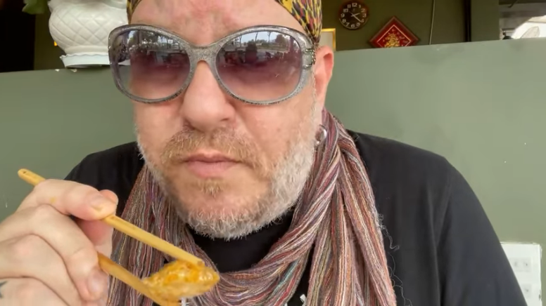 A snapshot from a video supplied by Jordy Trachtenberg shows him eating top mo (fried pork fat) at a restaurant in Ho Chi Minh City's District 1.