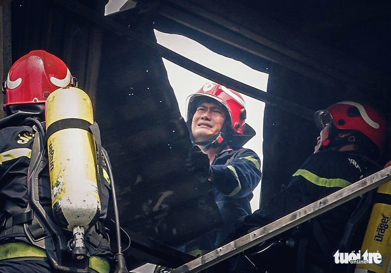 Nguyen Chi Thanh, an officer from a firefighting and rescue team, takes part in rescue operations in a real-life fire in Ho Chi Minh City.