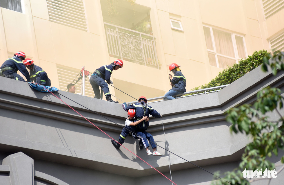 Firemen join a drill to rescue people trapped in a high-rise building fire in Ho Chi Minh City.