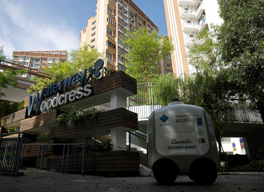 Carmello, an autonomous grocery delivery robot, makes its way during a delivery in Singapore April 6, 2021. Photo: Reuters