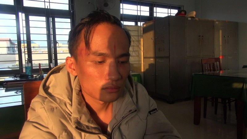 Pham Ngoc Tien is held at the police station in Quang Ngai Province, Vietnam in this supplied photo.