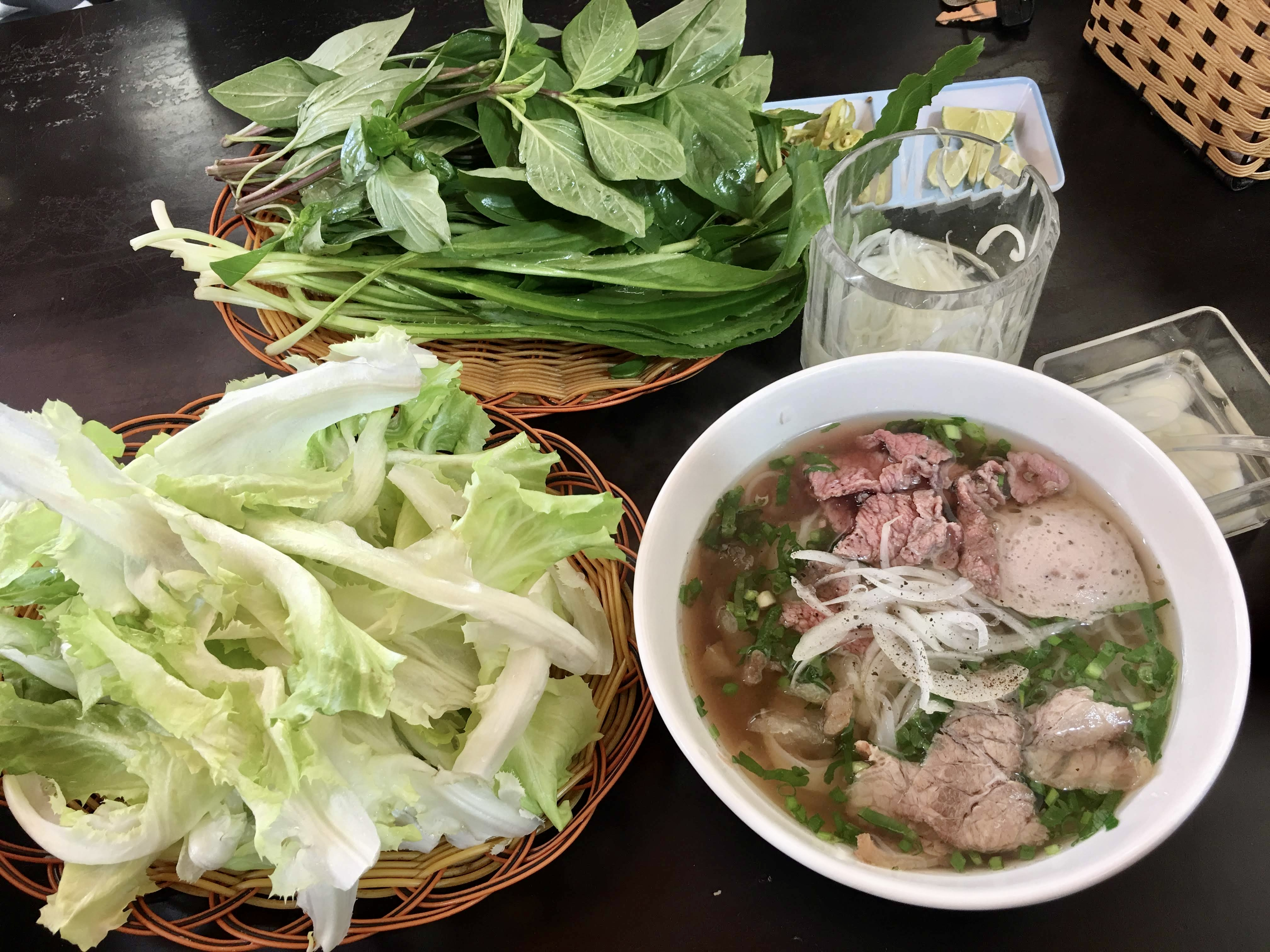 An illustration photo shows a bowl of pho served topped with a variety of meat and served with local veggies, at a pho stall in the Central Highlands City of Da Lat. Photo: Dong Nguyen / Tuoi Tre News
