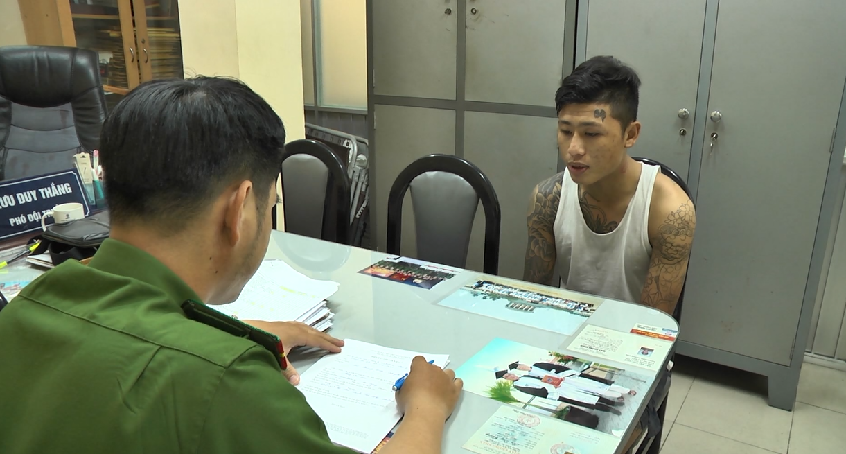 Pham Truong Hung Cuong is held at a police station in Ho Chi Minh City in this supplied photo.