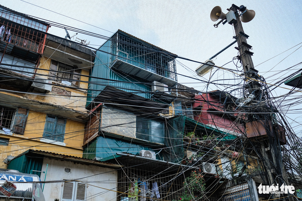 Many residents in the Van Chuong condominium area have illegally enlarged their apartments. Photo: Nam Tran / Tuoi Tre