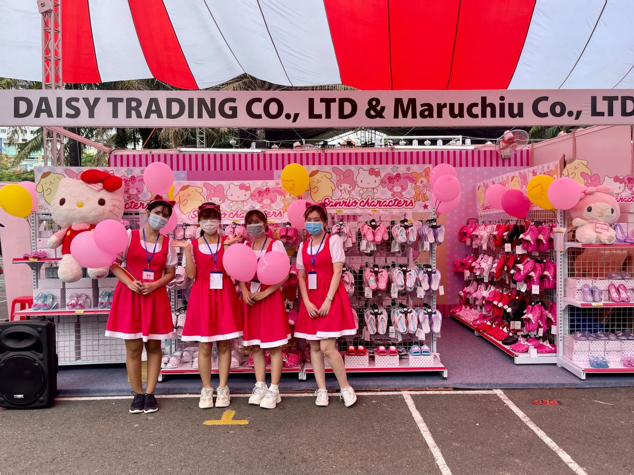 Staff pose for a photo at a booth selling Hello Kitty products at the Japan Vietnam Festival in Ho Chi Minh City on April 17, 2021. Photo: Dong Nguyen / Tuoi Tre News
