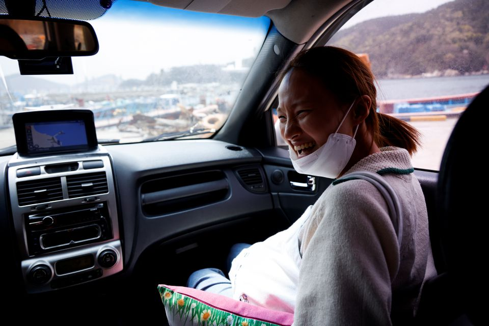 Jin So-hee, 28, a haenyeo, also known as a 'sea woman', talks to her colleague Woo Jung-min (not pictured) on the way to work in Geoje, South Korea, March 30, 2021. Photo: Reuters