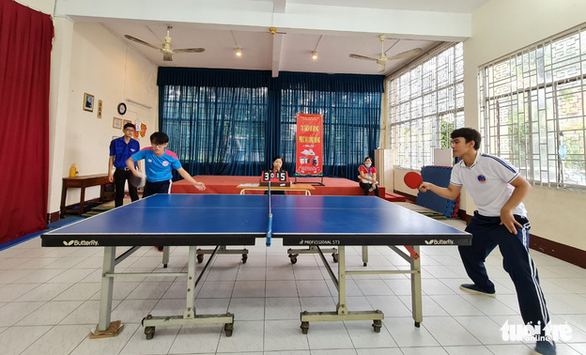 Youths with disabilities compete in table tennis in a sports tournament held on April 18, 2021 in Tan Binh Sports Center in Tan Binh District, Ho Chi Minh City. Photo: Cong Trieu / Tuoi Tre