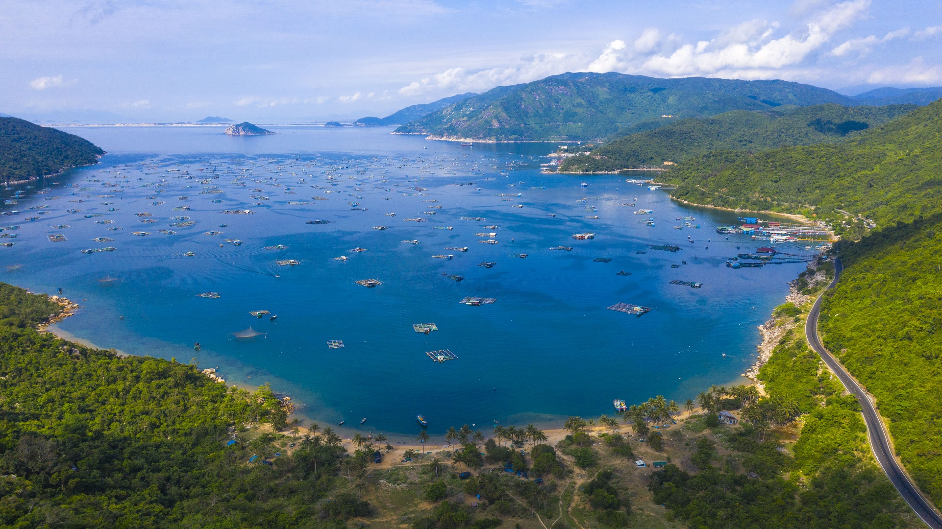 A bird's eye view photo shows aquatic farms in the central province of Phu Yen's Vung Ro Bay. Photo: Quang Dinh / Tuoi Tre News