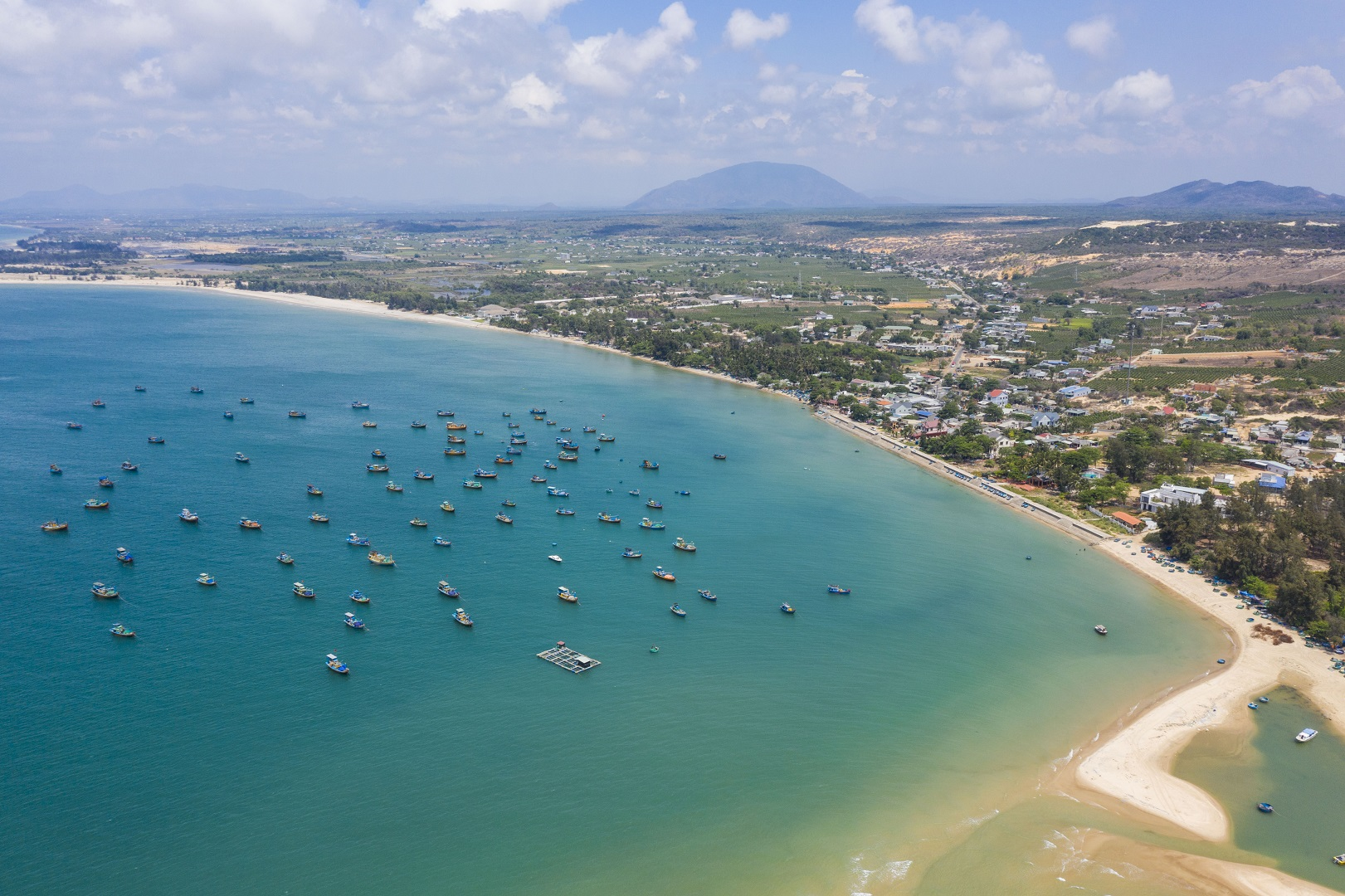 A bird's eye view photo captures fishing boats off shore Ho Tram Beach in the southern province of Ba Ria – Vung Tau. Photo: Quang Dinh / Tuoi Tre News