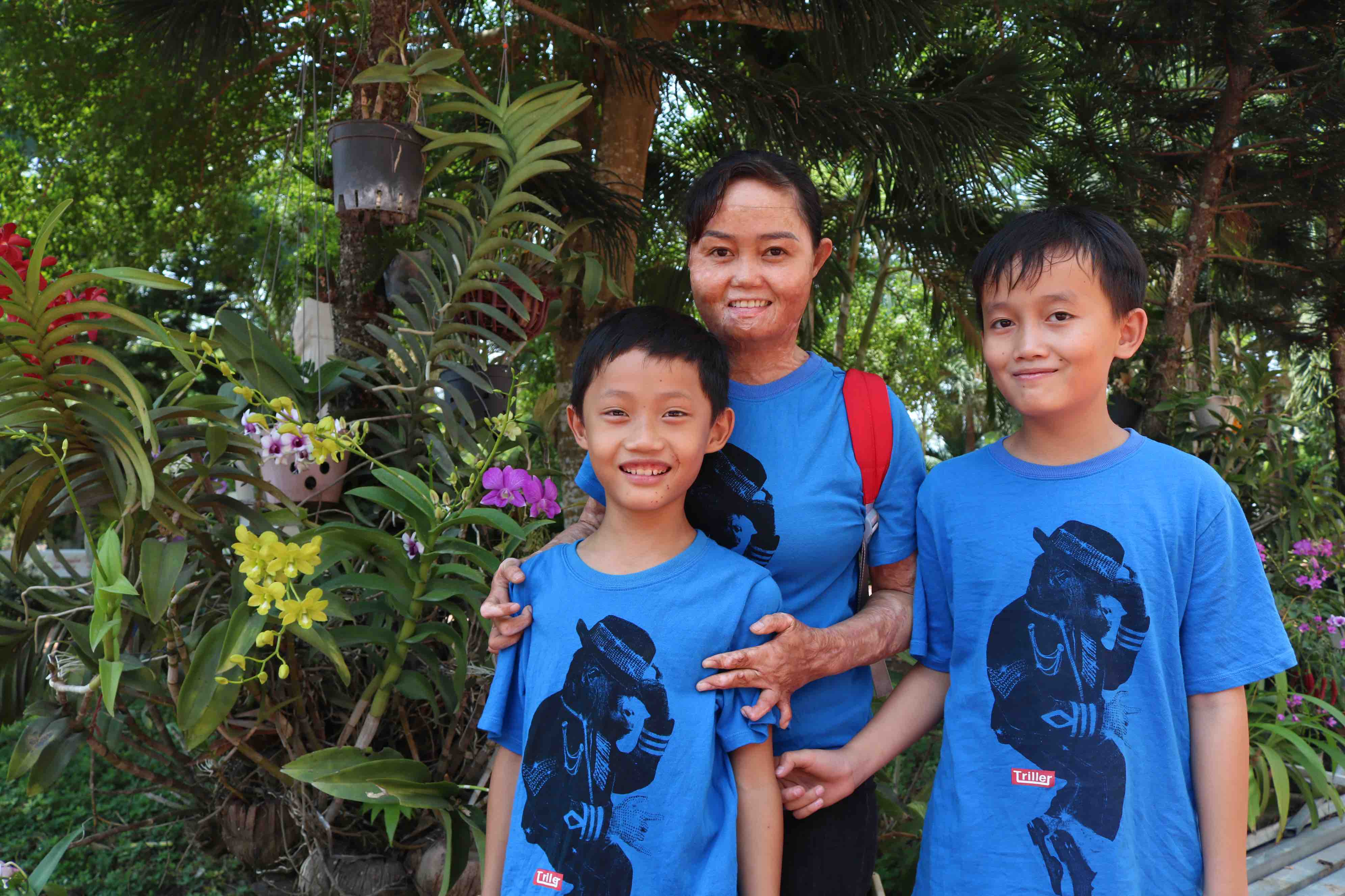 Ngan and her two children. Photo: Hoang An / Tuoi Tre