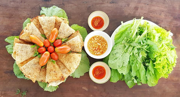 A supplied photo of a plate of crab rolls (left) prepared by singer Anh Tuyet at her house in Hoi An City, Quang Nam Province, Vietnam.