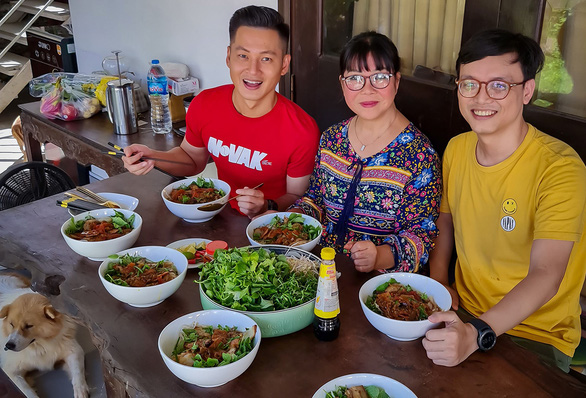 A supplied photo of Singer Anh Tuyet (middle) enjoying food she prepared for a friendly gathering at her house in Hoi An City, Quang Nam Province, Vietnam.